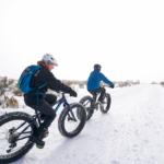 two people fat biking on groomed trails